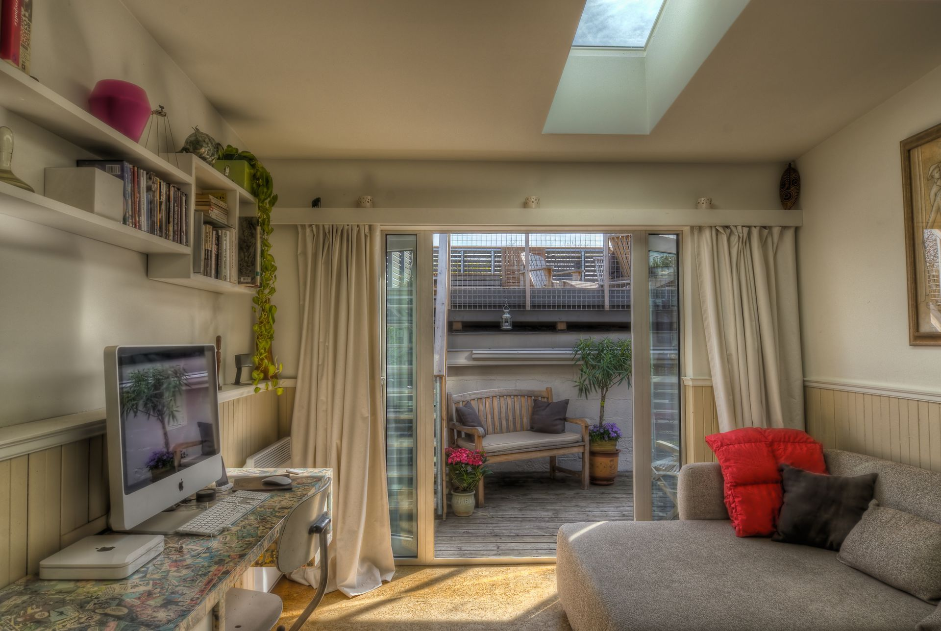 Living Room With Skylight And Patio Doors Open To Outdoor Living. Stairs To  Terrace To ...