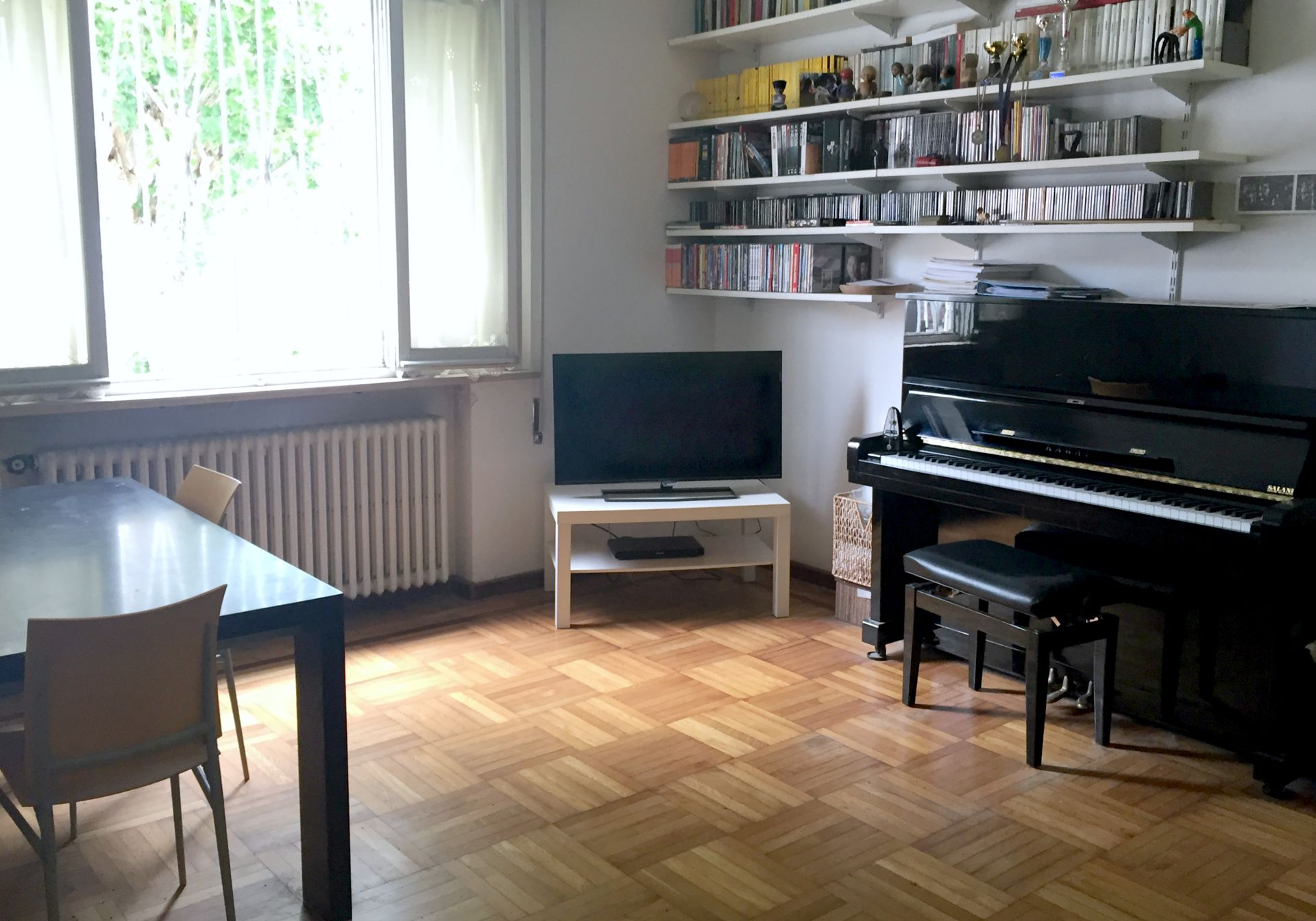 Tv and piano corner, lot of cd, books and DVD at your disposa