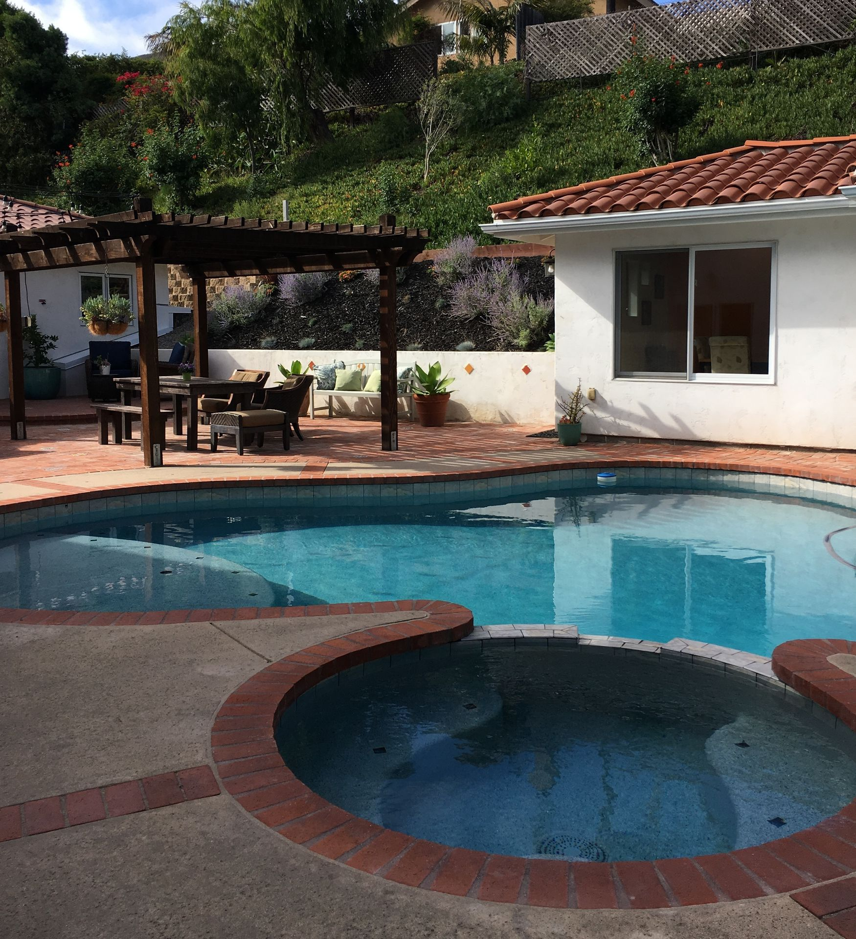 Attractive Patio, Pool With Hot Tub, And Outdoor Eating Area.