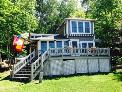 Large lakefront home on Frye Island with beautiful sandy beach
