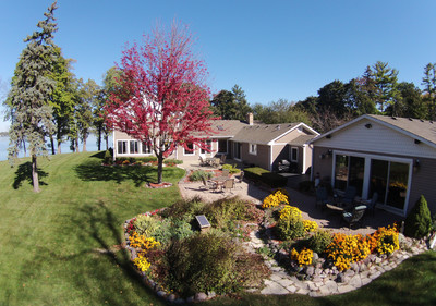 Upscale 7000 sq ft lakehouse with sunset views close to Chicago